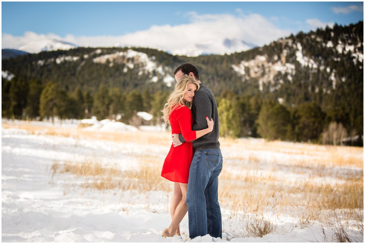 blonde red dress snow engagement
